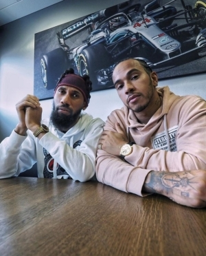 Phyno Hangs Out With British Racing Driver, Lewis Hamilton In Spain